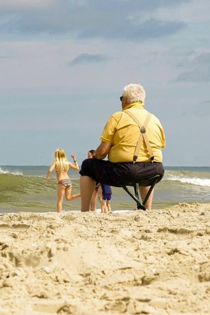 grandpa with grandkids at beach