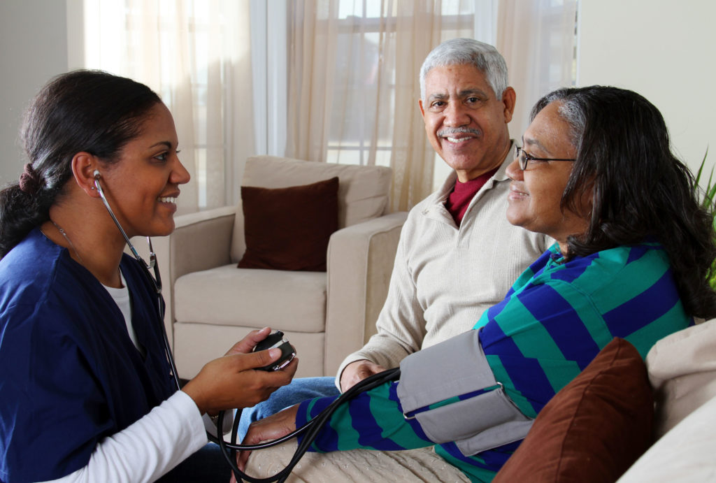 Nurses taking care of senior citizens in their homes