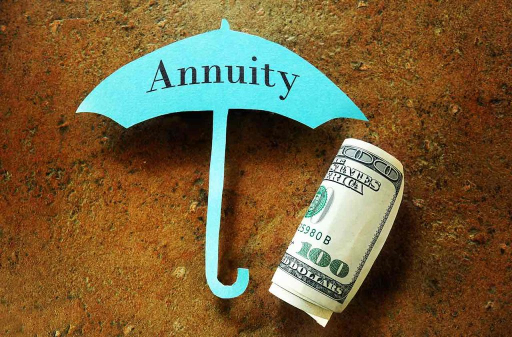 Hundred dollar bill under a paper umbrella with Annuity text